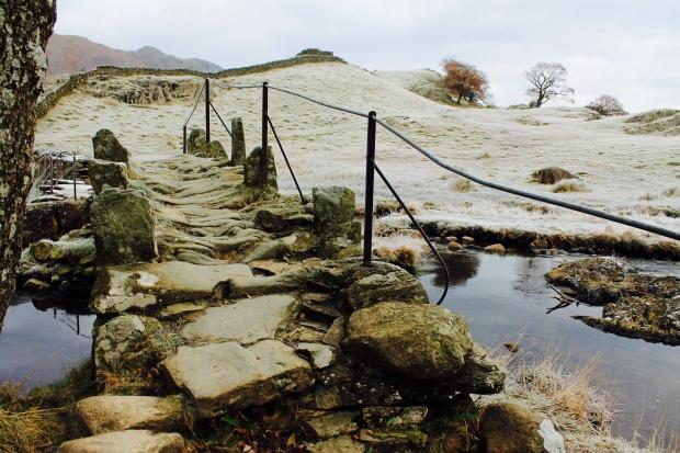 Stone bridge over stream in Lake District, Cumbria