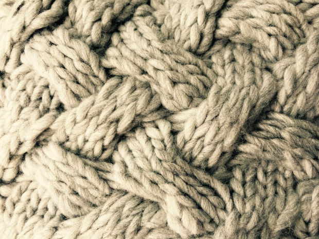 Close up picture of a chunky weave knit