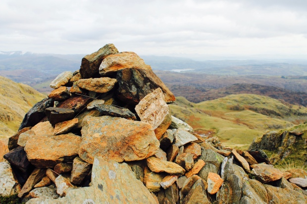 Stone cairn on top of Birk Fell in Lake District National Park
