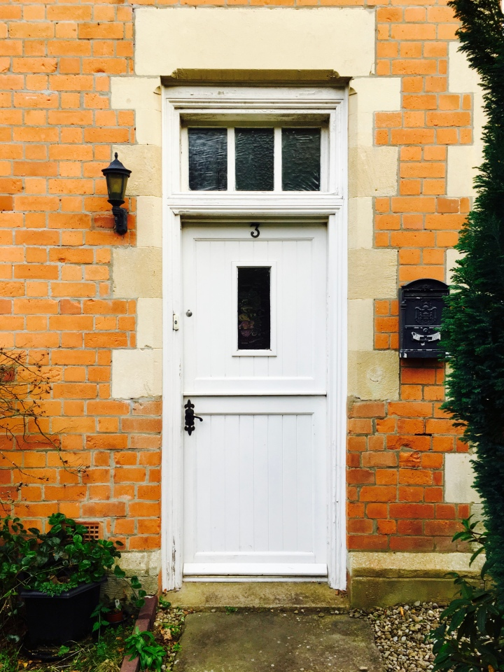 Front door to house in Victorian-era building