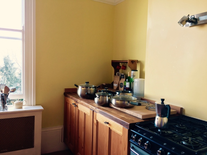 Yellow kitchen with range cooker