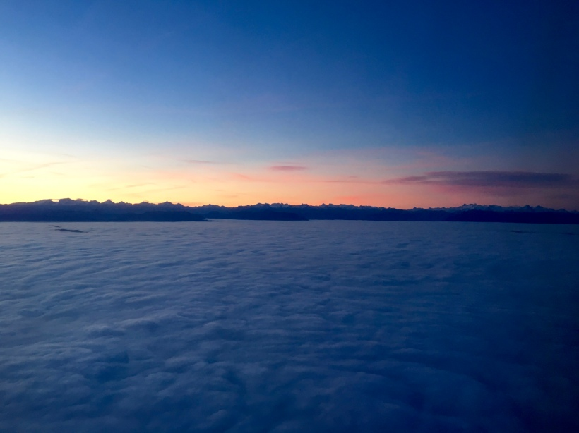 Sunrise aboard a plane flying over Switzerland.