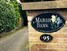 'Marsh Bank' name plaque in front of English house