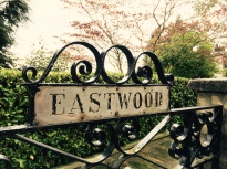 'Eastwood' name plaque on front gate of English house