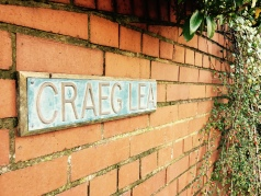 Craig Lea name plaque in front of English house