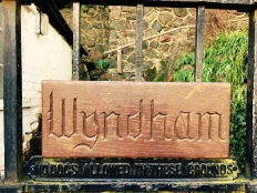 'Wyndham' name plaque on front gate of English house