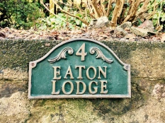 'Eaton Lodge' name plaque in front of English house