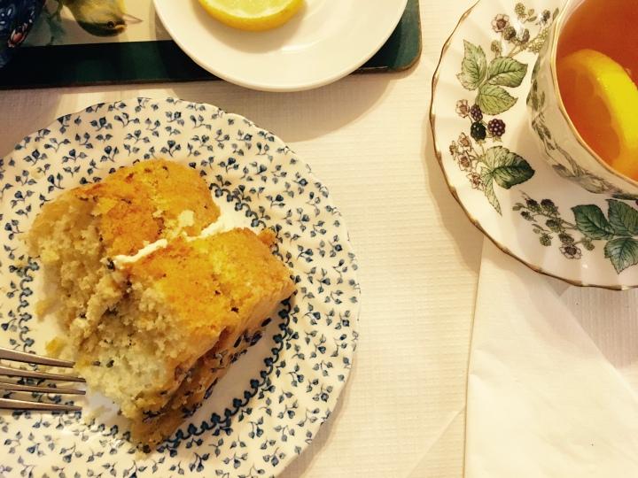 Orange and lavender cake and earl grey tea with lemon served on mismatched, vintage porcelain