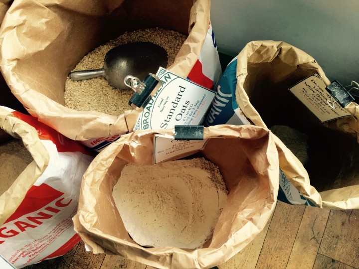 Bags of flour and oats at a providores shop in Ludlow, Shropshire