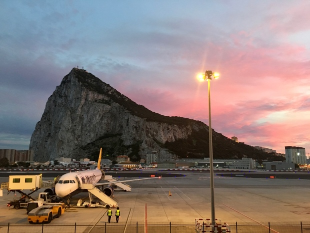 Looking towards the Rock of Gibraltar from the airport during a pink sunset.