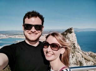 Couple posing for a picture in front of the Rock of Gibraltar.