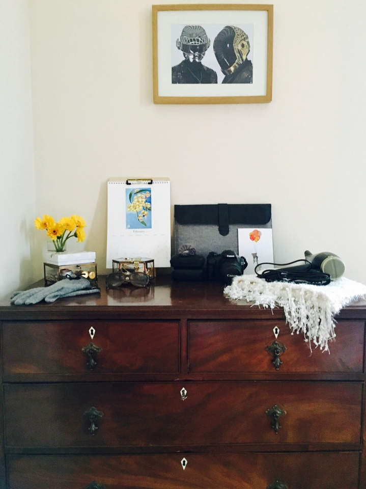 A chest of drawers that's been transformed into a dressing table.