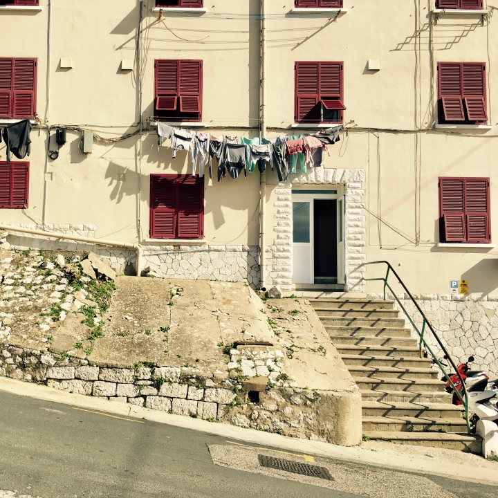 Washing hanging outside of an apartment block in Gibraltar.