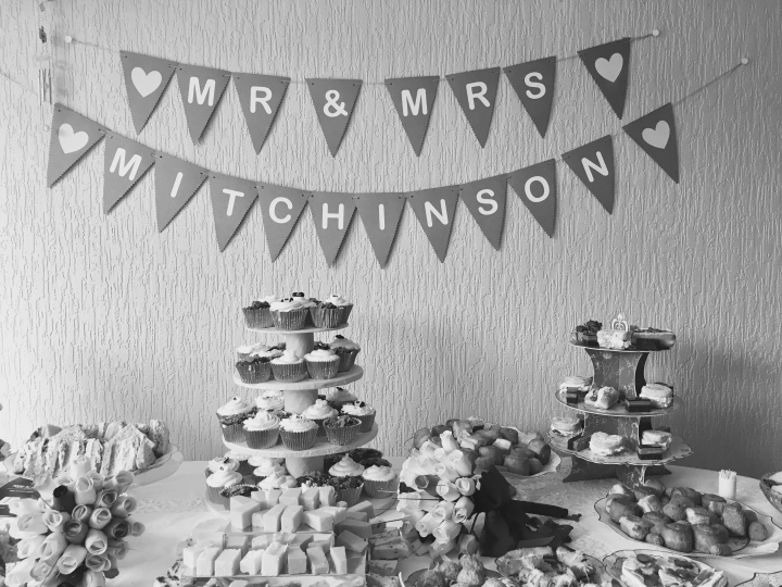 Bunting and food at a wedding reception.
