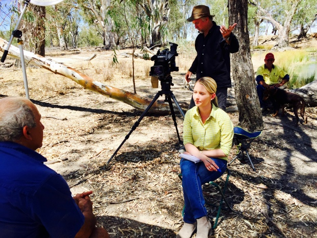 Australian journalist doing a television interview in the bush.