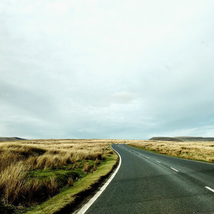Road winding through the Brecon Beacon National Park, in Wales.