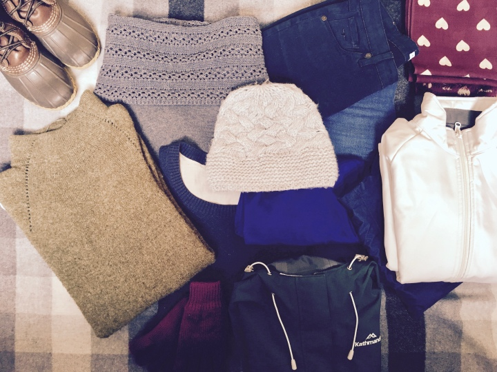 Flat lay of clothes to be taken to Latvia on a six day holiday in early March.