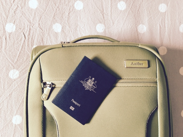 Small suitcase and Australian passport.
