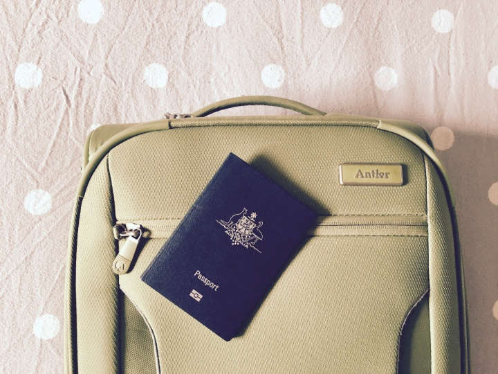 Small suitcase and Australian passport.
