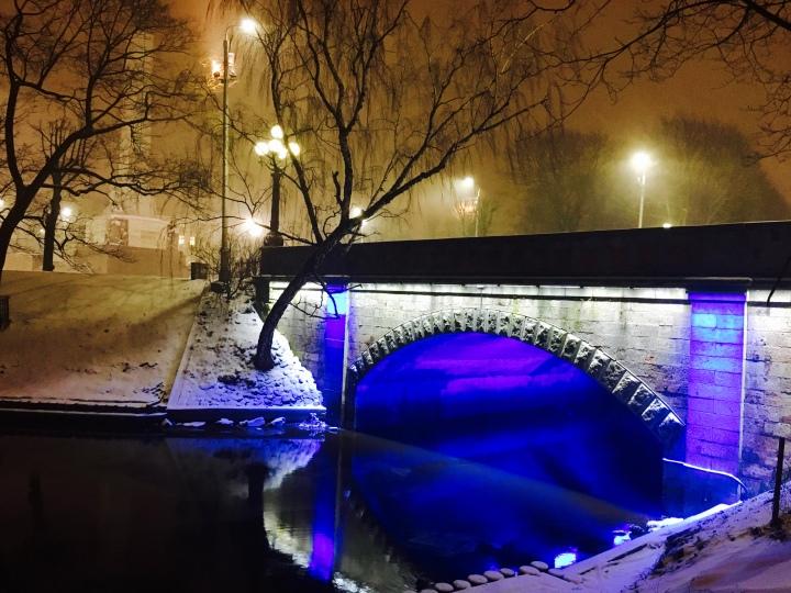Snow falling in central Riga, Latvia at night.