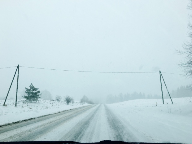 Driving during a snowstorm in regional Latvia.