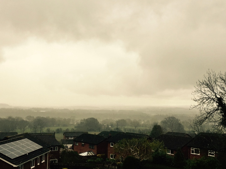 A grey cloudy sky overlooking houses in the Severn Valley, Worcestershire, England.