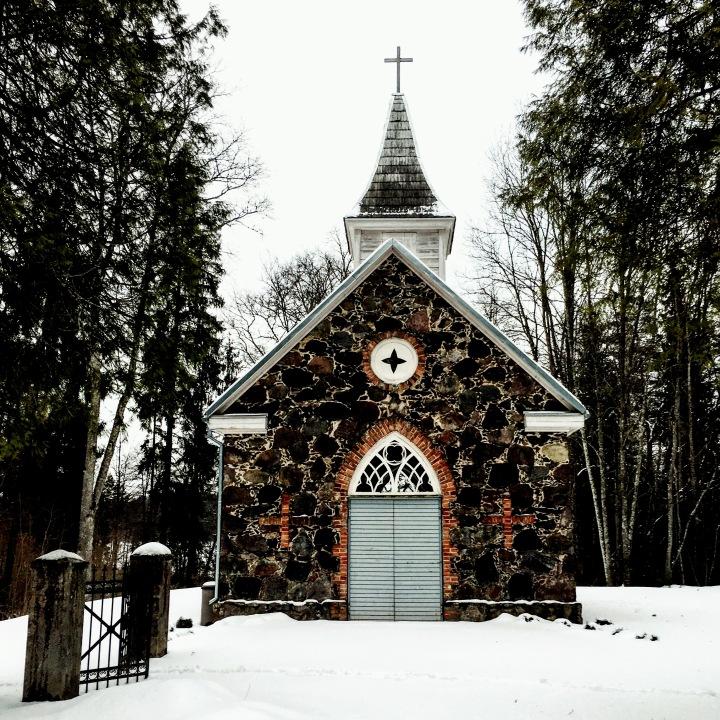Snow covered church in Raiskums, Latvia.