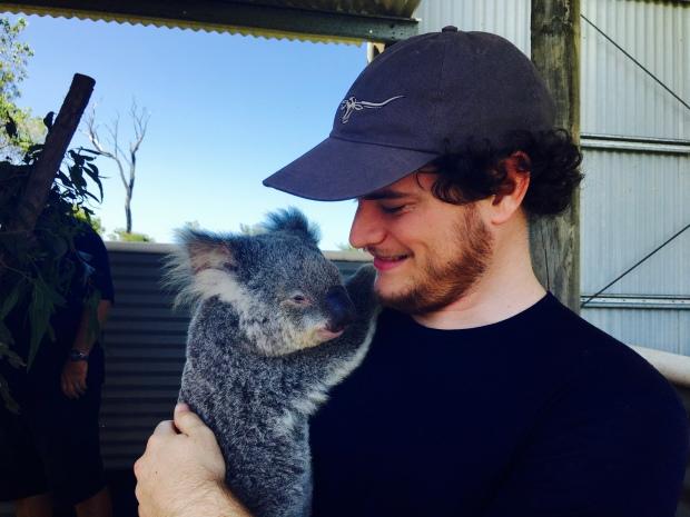 Man holding koala.
