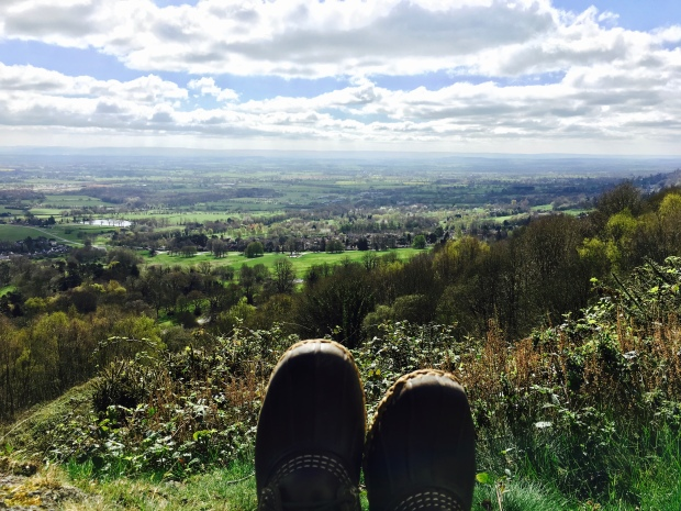 A pair of Bean Boots in the foreground with a view of the Severn Valley in the background.