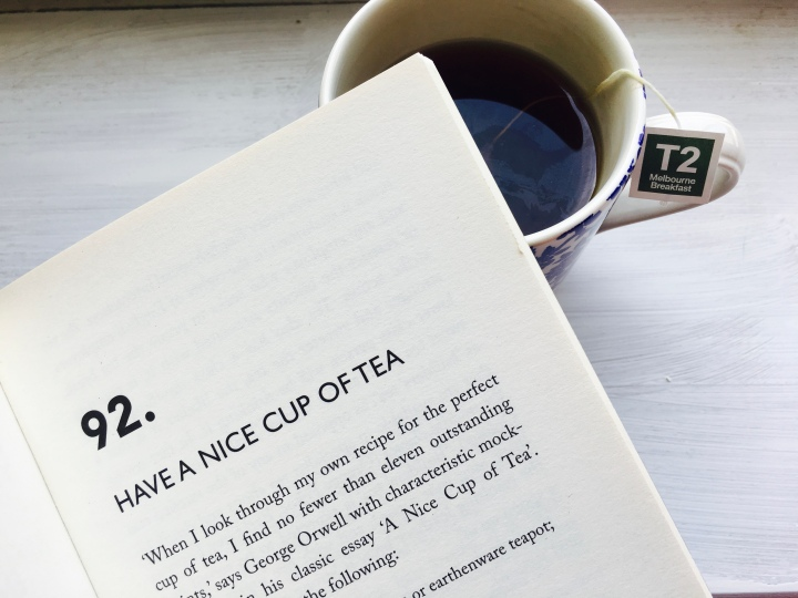 Open book and mug of tea.