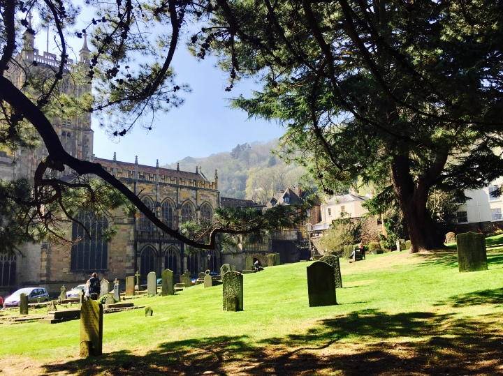 The grounds of the Malvern Priory on a sunny spring day.