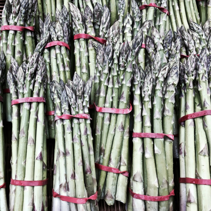 Bunches of asparagus in a wicker basket