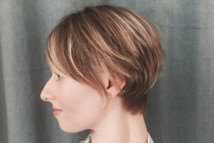 Woman with short pixie cut style bob.