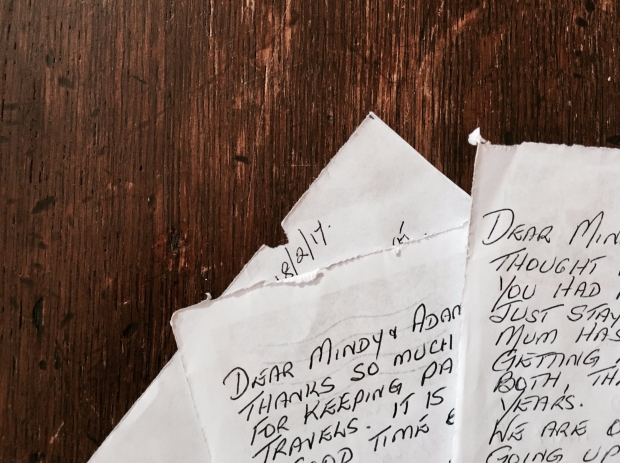 Handwritten notes on timber table.