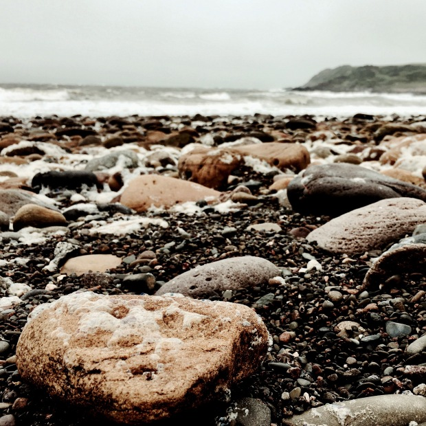 The stone filled beach at Port Mary, Dumfries and Galloway, Scotland.