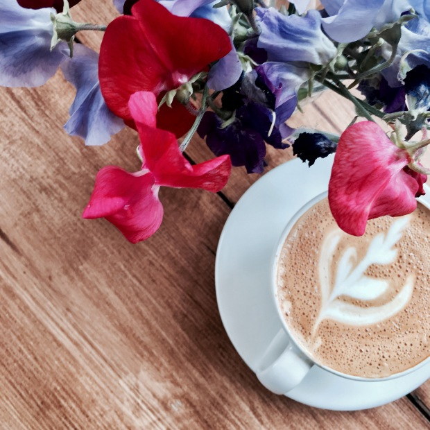 Coffee and sweet pea flowers