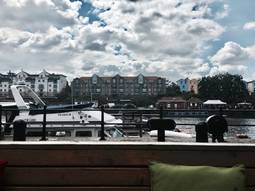 Boats and houses around the Bristol Harbourside.
