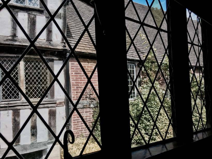 Looking through windows at National Trust property, Greyfriars' in Worcester, Worcestershire.
