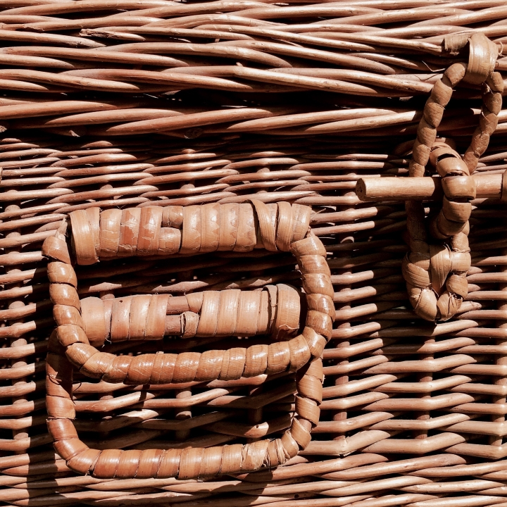 Close up of a wicker picnic basket.