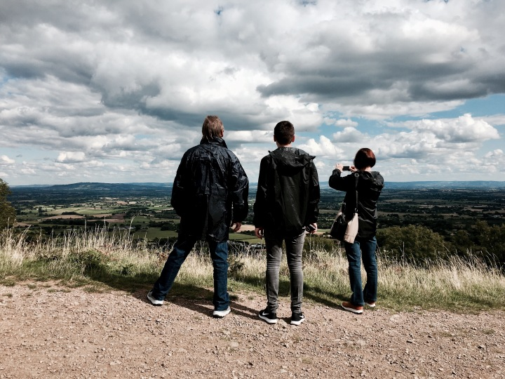 Tourists taking in the view from the Malvern Hills, Worcestershire, England.