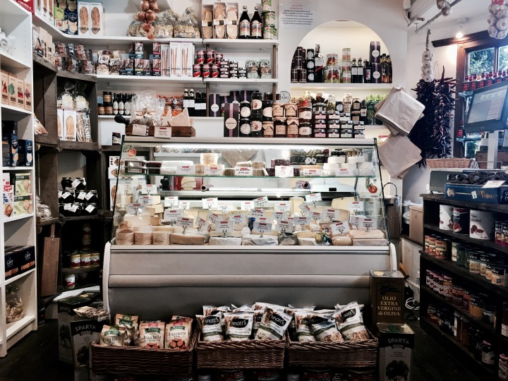 Cheese counter at Broadway Deli in Broadway, Worcestershire, England.