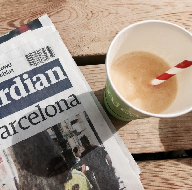 Guardian newspaper and a fruit smoothie.