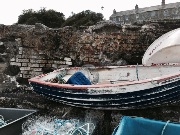 Boat and fishing nets at Charlestown Harbour, Cornwall, England.