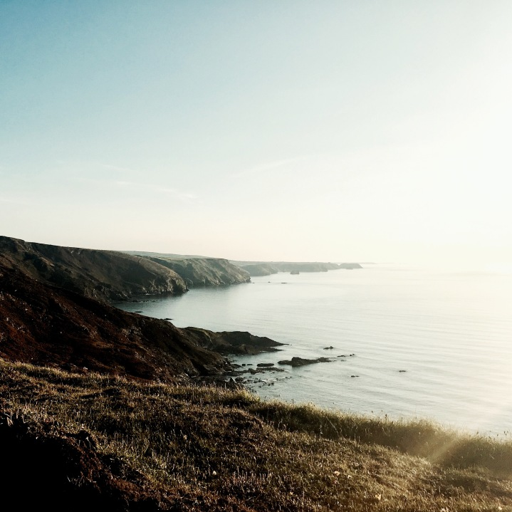 The view from the cliffs above The Strangles beach in Cornwall, England.