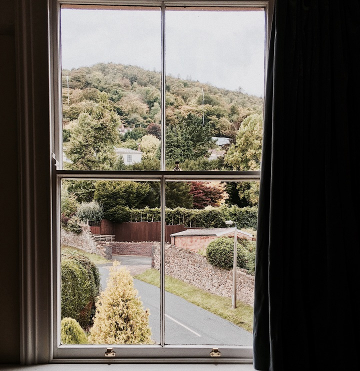 Looking out of a window towards the Malvern Hills in Worcestershire, England.