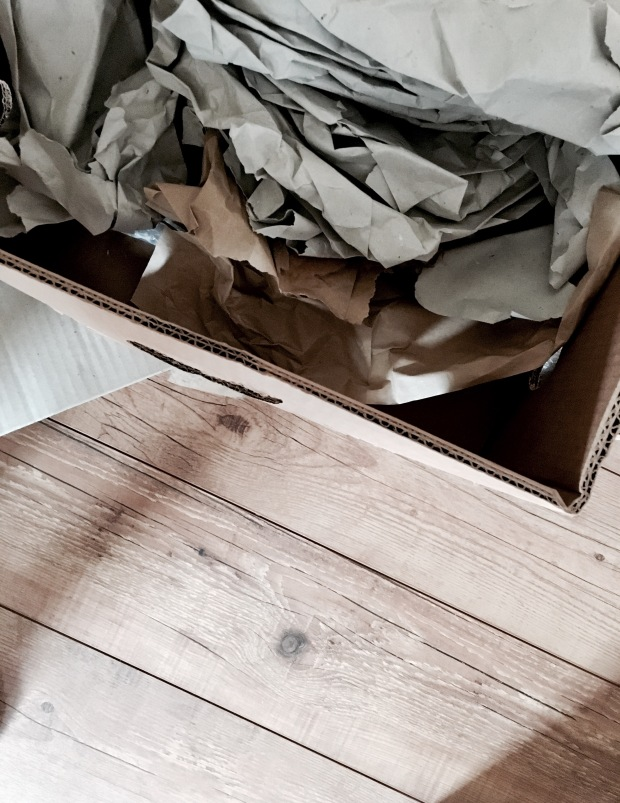 Moving boxes sitting on a wooden floor.