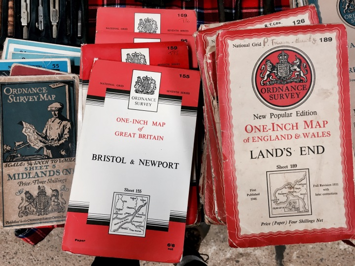 Piles of old maps at a flea fair in Malvern, Worcestershire, England.