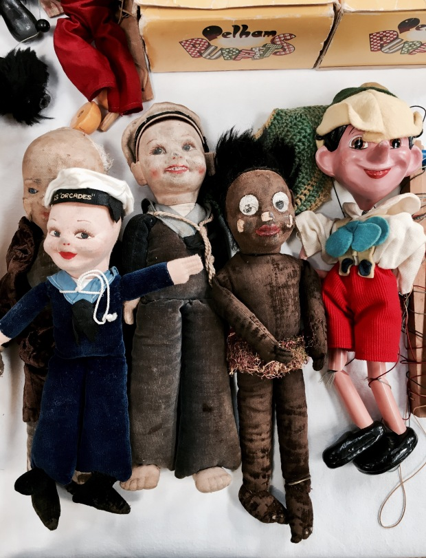 Old dolls and puppets for for sale at a flea fair in Malvern, Worcestershire, England.