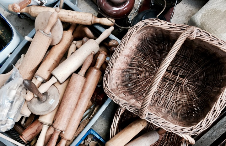Wooden rolling pins and and a basket at a flea fair in Worcestershire, England.
