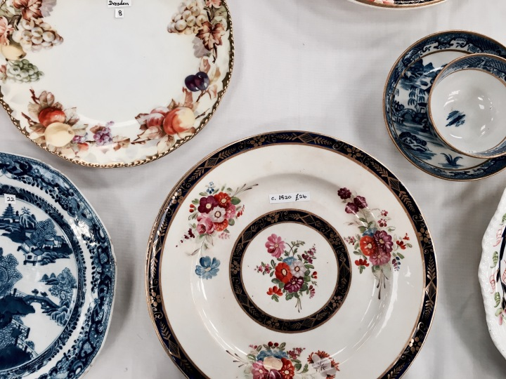 Plates displayed at a flea fair in Malvern, Worcestershire, England.
